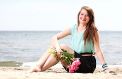 Young beautiful woman portrait on the beach bunch flower Stock Images