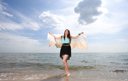 Young beautiful woman portrait on the beach Stock Photos