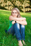 Young beautiful woman portrait on grass Royalty Free Stock Photos