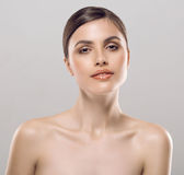 Young beautiful woman portrait with healthy skin studio Stock Image