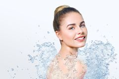 Young beautiful woman with water splash Stock Photos