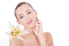 Young beautiful woman portrait with white flower Royalty Free Stock Photos