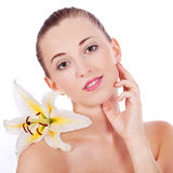 Young beautiful woman portrait with white flower Stock Images