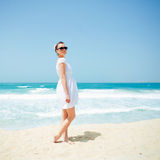 Young beautiful woman posing on the beach. In the summertime Royalty Free Stock Photos