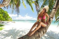 Young beautiful woman posing on the beach Stock Photo