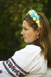 Young beautiful woman posing in 40 beautiful floral wreath on he Stock Photos
