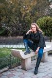 Young beautiful woman posing at camera outdoors. stock photos