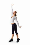 Young beautiful woman posing in a gym outfit. Royalty Free Stock Photography