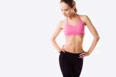 Young beautiful woman posing in a gym outfit. Stock Images