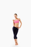 Young beautiful woman posing in a gym outfit. Royalty Free Stock Photos