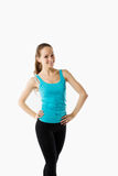 Young beautiful woman posing in a gym outfit. Stock Photography