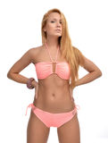 Young beautiful woman posing in modern pink pattern bikini swims Royalty Free Stock Photos