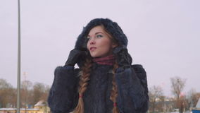 Young beautiful woman posing over winter forest. Outdoor winter portrait over snowy background. slow motion from 50 fps stock footage
