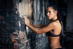 Young beautiful woman posing in ruins Stock Photography