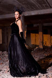 Young beautiful woman posing in ruins Stock Images