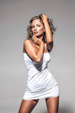 Young beautiful woman posing in white dress Stock Photo
