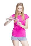 Young beautiful woman pours water into a glass Royalty Free Stock Image