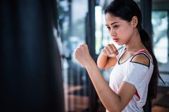 Young beautiful woman practicing boxing in gym. stock images