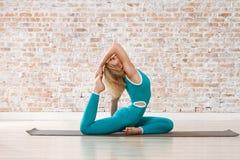 Young Beautiful Woman Practicing Yoga Stock Photos