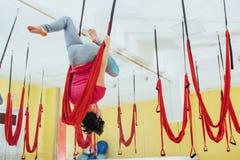 practicing yoga exercises / shoulderstand  sarvangasana