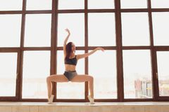Young beautiful woman practicing yoga and gymnastic. Wellness concept. Classes in single sports. Young beautiful woman practicing yoga and gymnastic. Wellness royalty free stock photos
