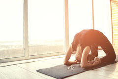 Young beautiful woman practicing yoga and gymnastic. Wellness concept. Classes in single sports. Royalty Free Stock Photo
