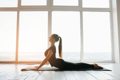 Young beautiful woman practicing yoga and gymnastic. Wellness concept. Classes in single sports. Young beautiful woman practicing yoga and gymnastic. Wellness stock photo