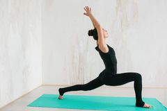 Young beautiful woman practicing yoga and gymnastic. Wellness concept. Classes in single sports. Caring for your body royalty free stock photo