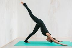 Young beautiful woman practicing yoga and gymnastic. Wellness concept. Classes in single sports. Caring for your body royalty free stock photos