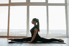 Young beautiful woman practicing yoga and gymnastic. Wellness concept. Classes in single sports. Stock Images