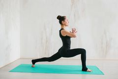 Young beautiful woman practicing yoga and gymnastic. Wellness concept. Classes in single sports. Caring for your body stock photo
