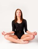 Pretty girl doing meditation exercise Stock Photography