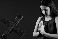 Young and beautiful woman praying Royalty Free Stock Photography
