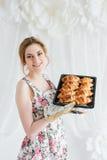 Young beautiful woman preparing homemade croissants Stock Photo