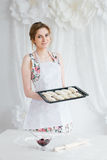 Young beautiful woman preparing homemade croissants Royalty Free Stock Image