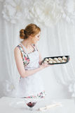 Young beautiful woman preparing homemade croissants Stock Images