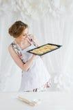 Young beautiful woman preparing homemade croissants Stock Photos