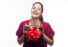 Young beautiful woman with present Royalty Free Stock Photography