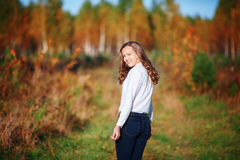 Young beautiful woman. Pretty girl in bright autumn park Royalty Free Stock Photography