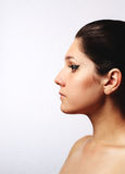 Young beautiful woman in profile Royalty Free Stock Images