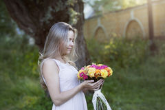Young beautiful woman in profile with a bright Royalty Free Stock Image