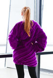 Young beautiful woman in purple jersey Royalty Free Stock Photo