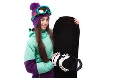 Young beautiful woman in purple ski coat and goggles hold snowbo. Isolated on white, brunette beauty young caucasian girl in purple ski costume and blue ski Stock Photography