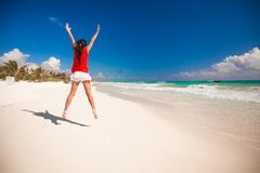 Young beautiful woman raises her arms up on the Royalty Free Stock Image
