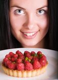 Young beautiful woman with raspberry cake Royalty Free Stock Photo