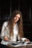 Young beautiful woman reading a book Stock Photos