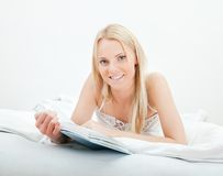 Young beautiful woman reading book Royalty Free Stock Image