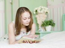 Young beautiful woman reading a book Stock Image