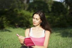 Young beautiful woman reading Stock Photos