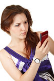 Young beautiful woman reading sms Royalty Free Stock Photos